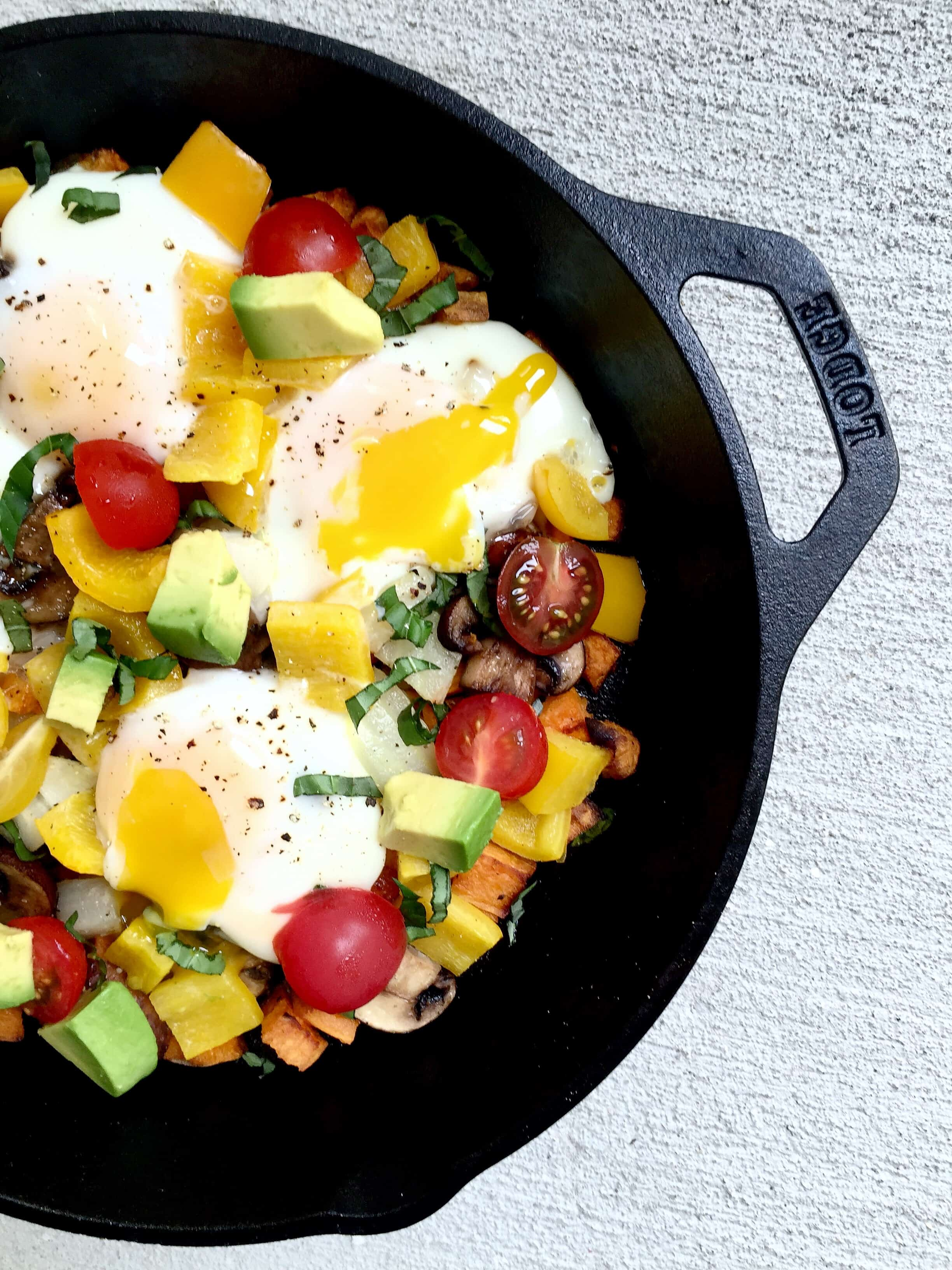vegetables and eggs in a cast iron skillet