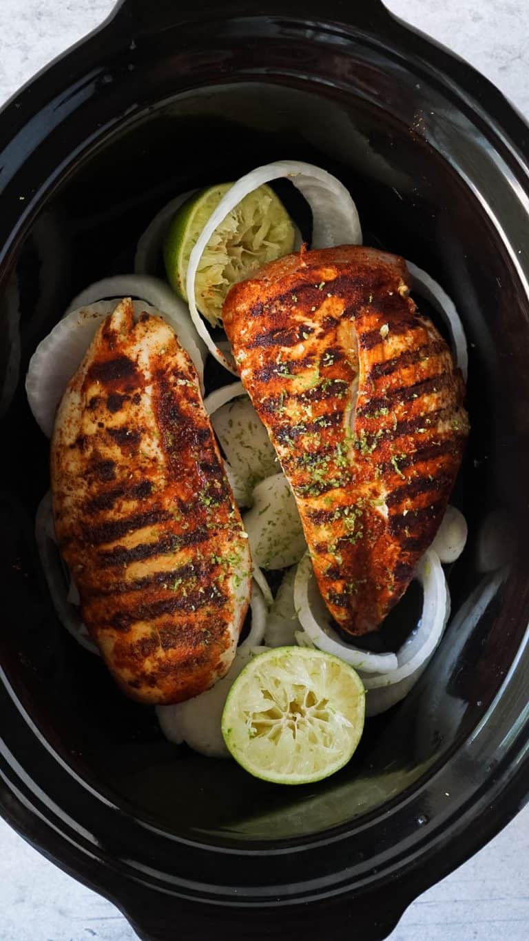 slow cooker chicken with onions and limes in a slow cooker