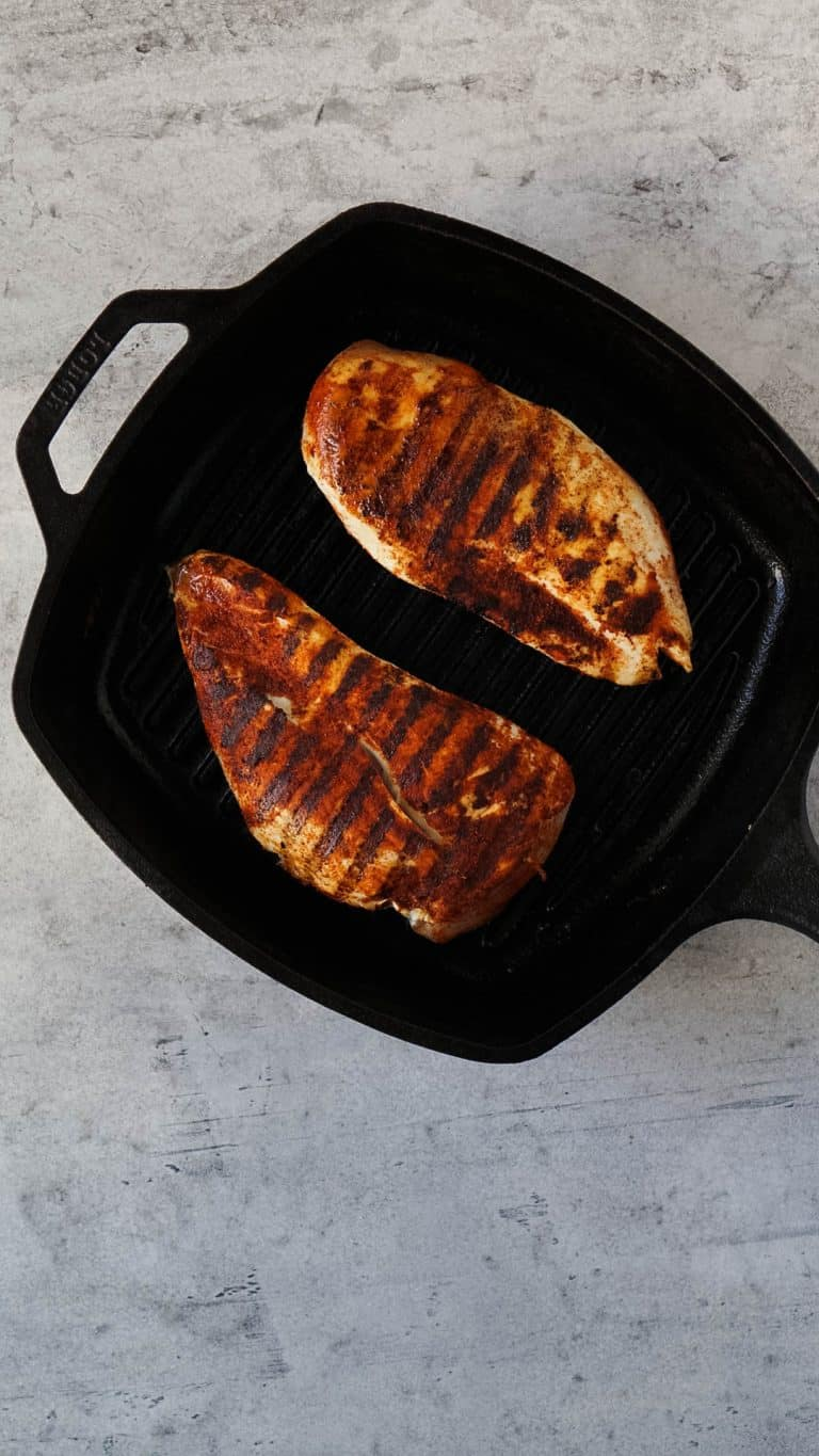 grilled chicken breasts in a cast iron pan