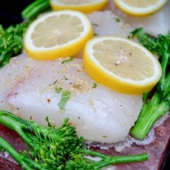 halibut on a salt block with broccolini and lemons