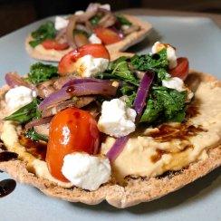 Pita pizza on a blue plate