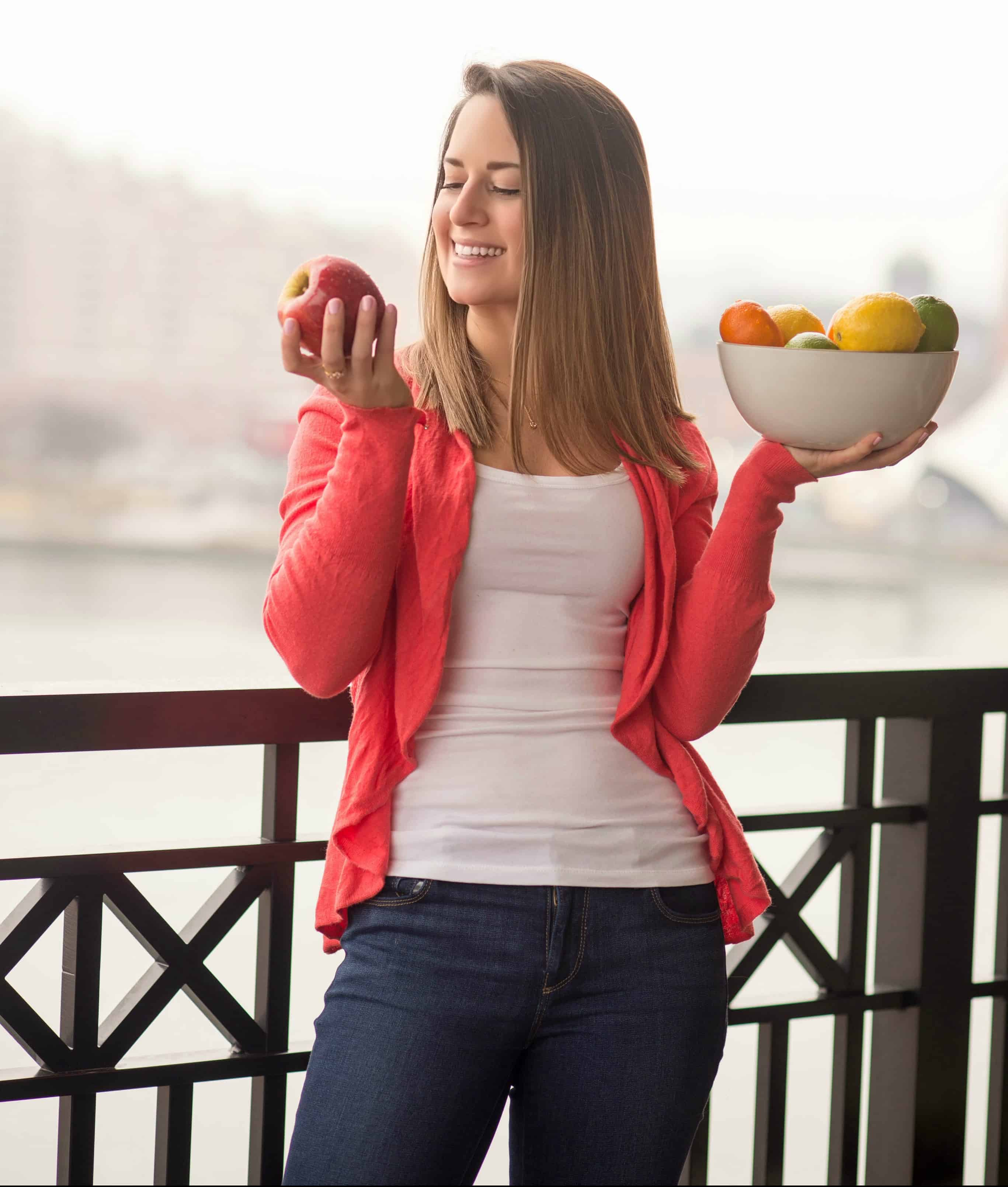 me holding a bowl of fruit