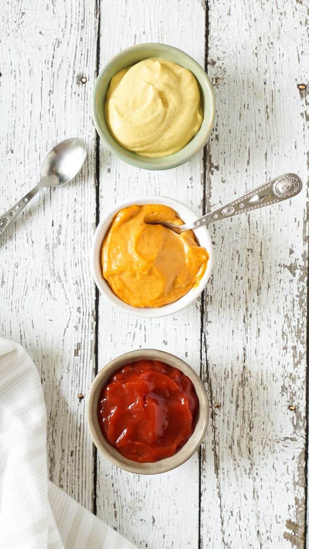 ketchup and mustard in 3 small bowls
