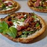 Pesto pita pizza with basil leaves