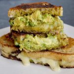 Pesto grilled cheese cut in half and stacked