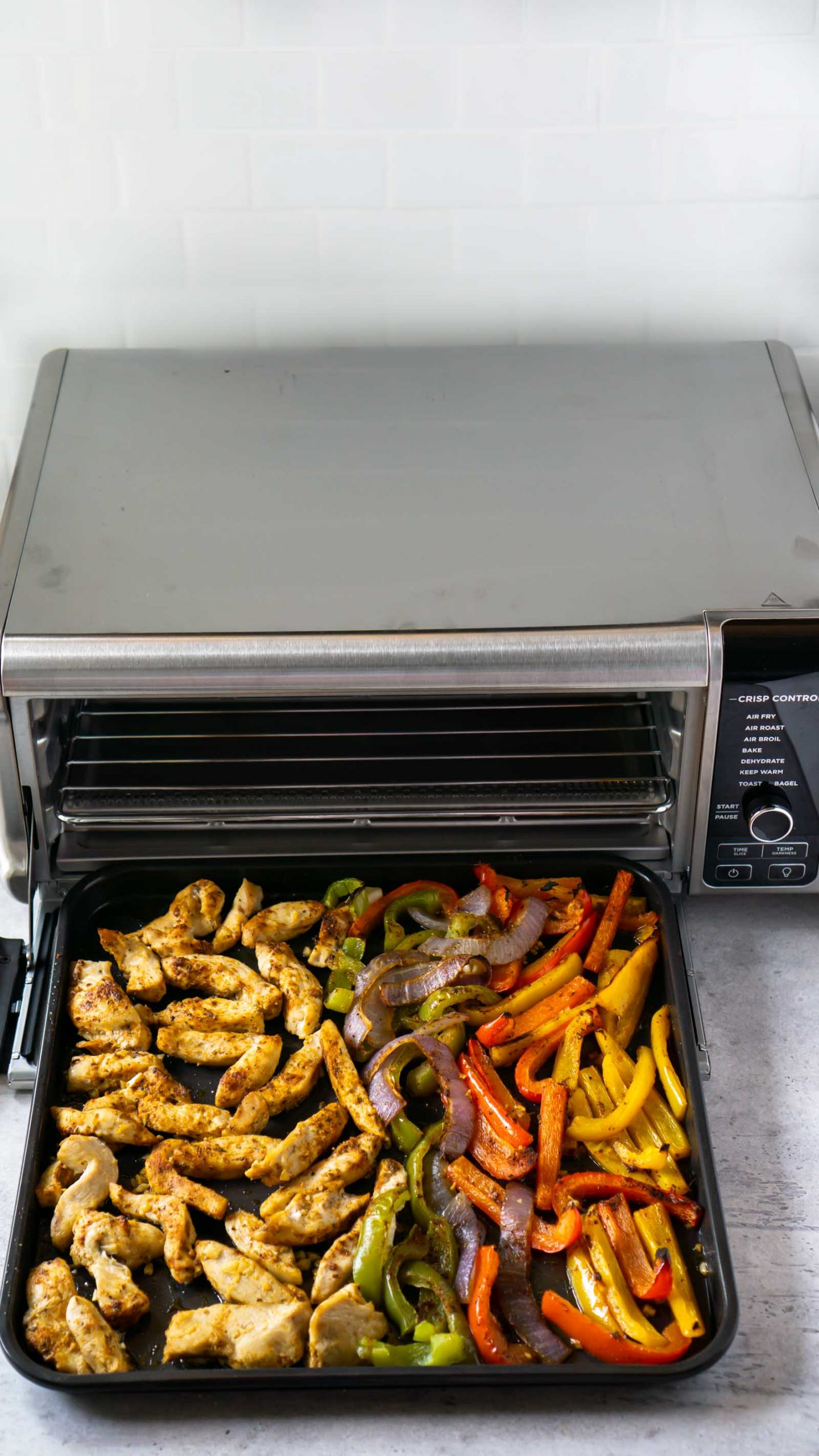 sheet pan chicken fajitas coming out of the oven
