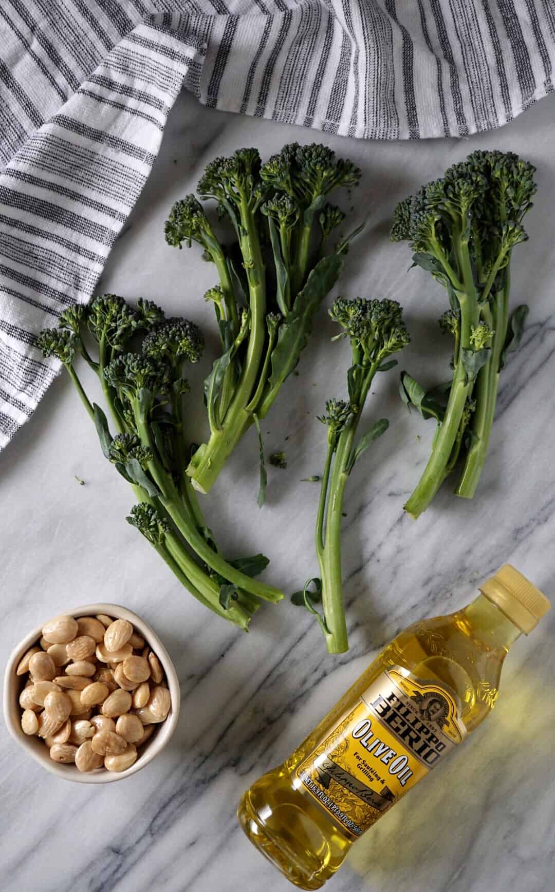Broccolini, marcona almonds, olive oil, and a dish towel