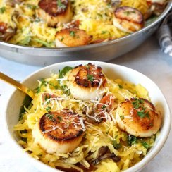 Seared scallops over spaghetti squash in a bowl