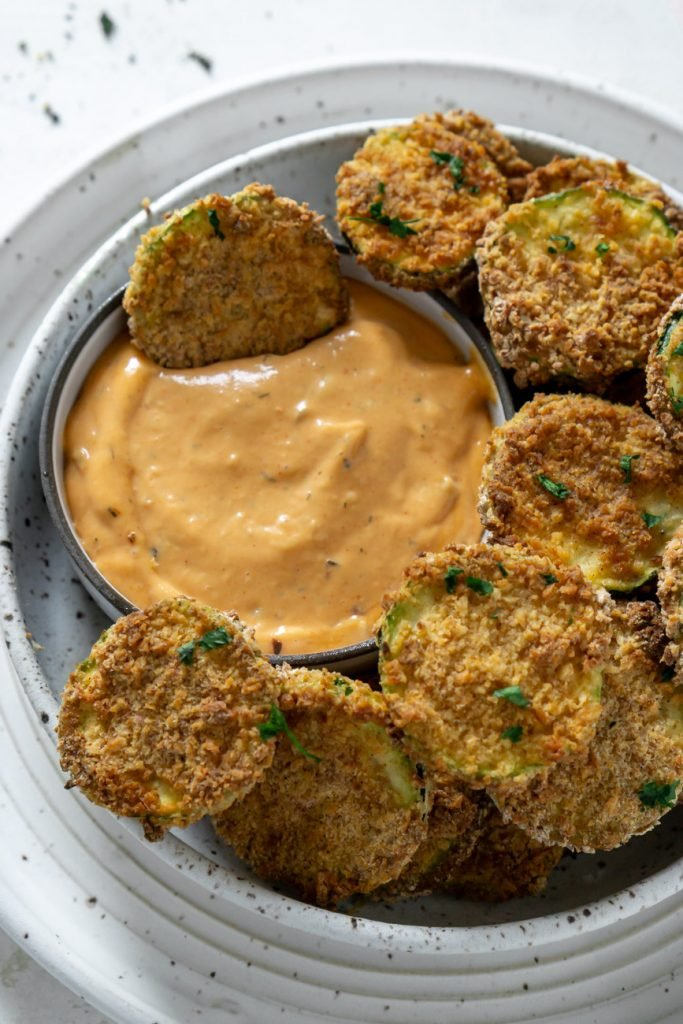 air fryer zucchini chip dipped in spicy mayo