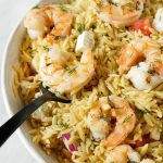 black fork serving garlic butter shrimp with orzo