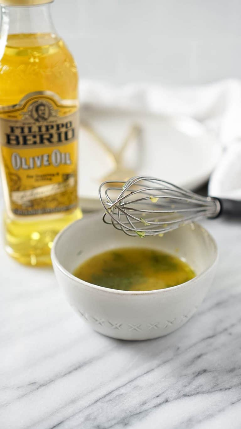 lemon vinaigrette with filippo berio olive oil and a whisk