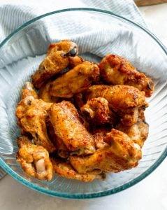 crispy air fryer chicken wings in a glass bowl
