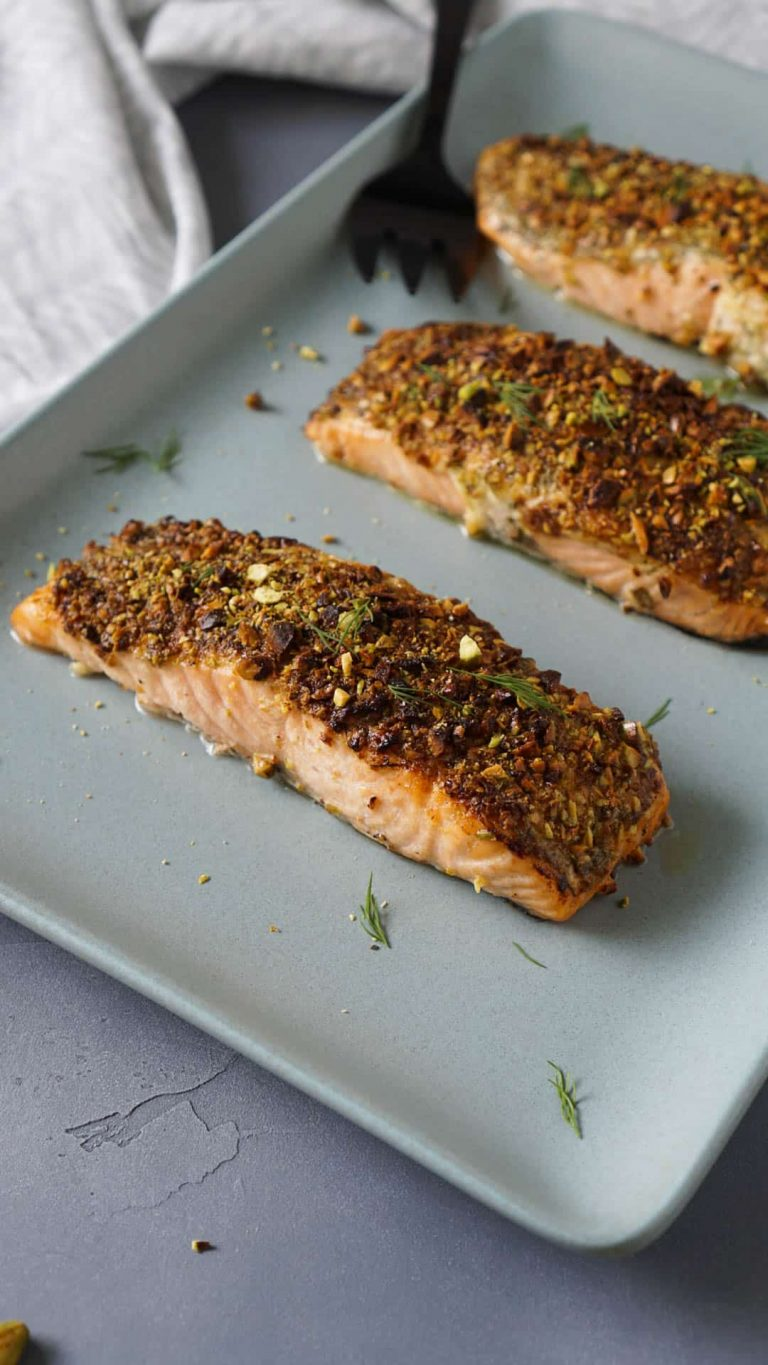 air fryer salmon on a blue serving tray with a black serving fork