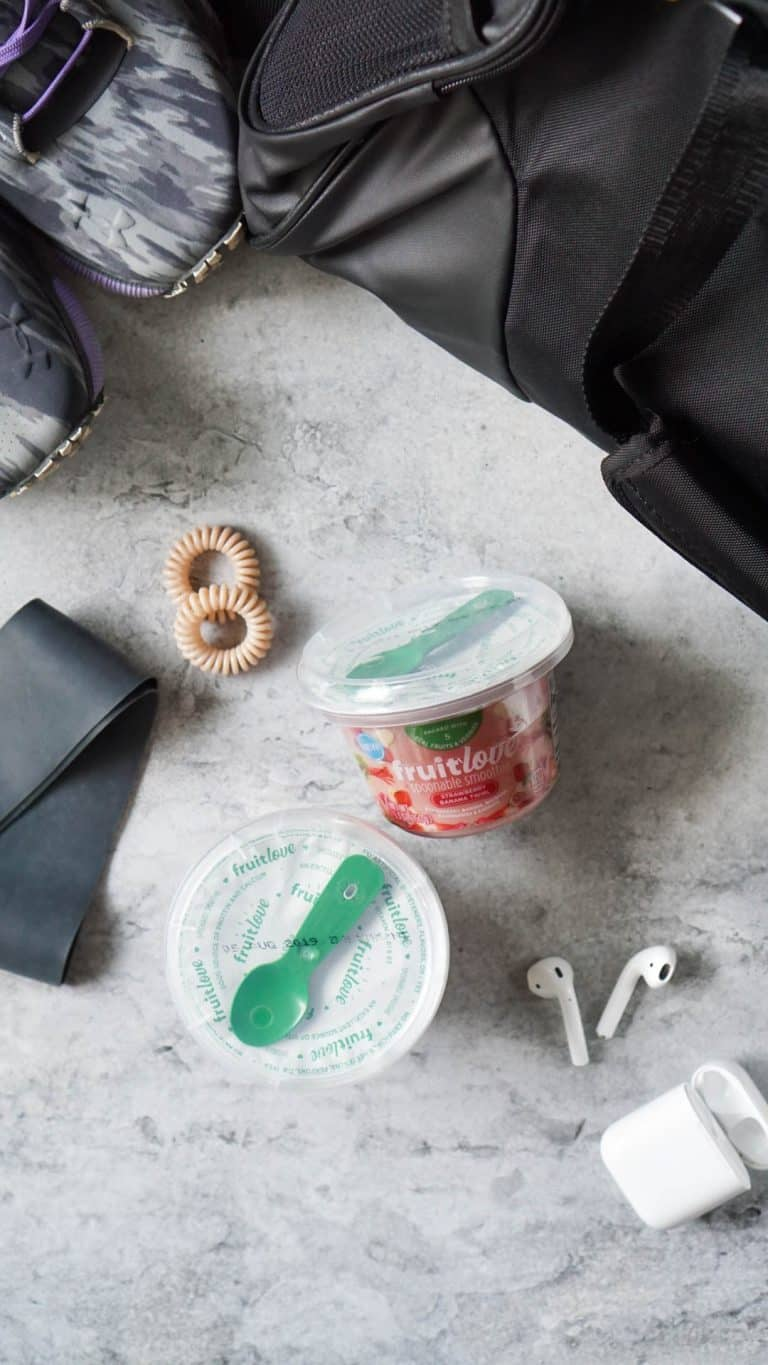 workout essentials - hair ties, headphones, shoes, and a post-workout snack