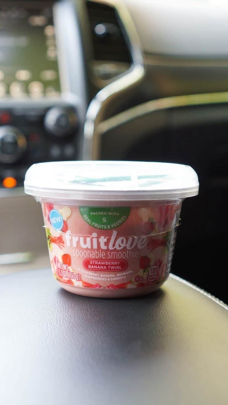 kraft smoothie cup in a car