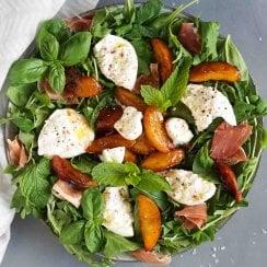 burrata salad on a large plate with a white napkin