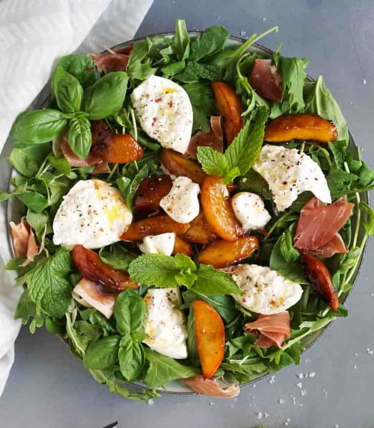 burrata salad on a large plate with a white napkin