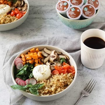 two quinoa breakfast bowls with a cup of coffee and k-cups in a blue bowl