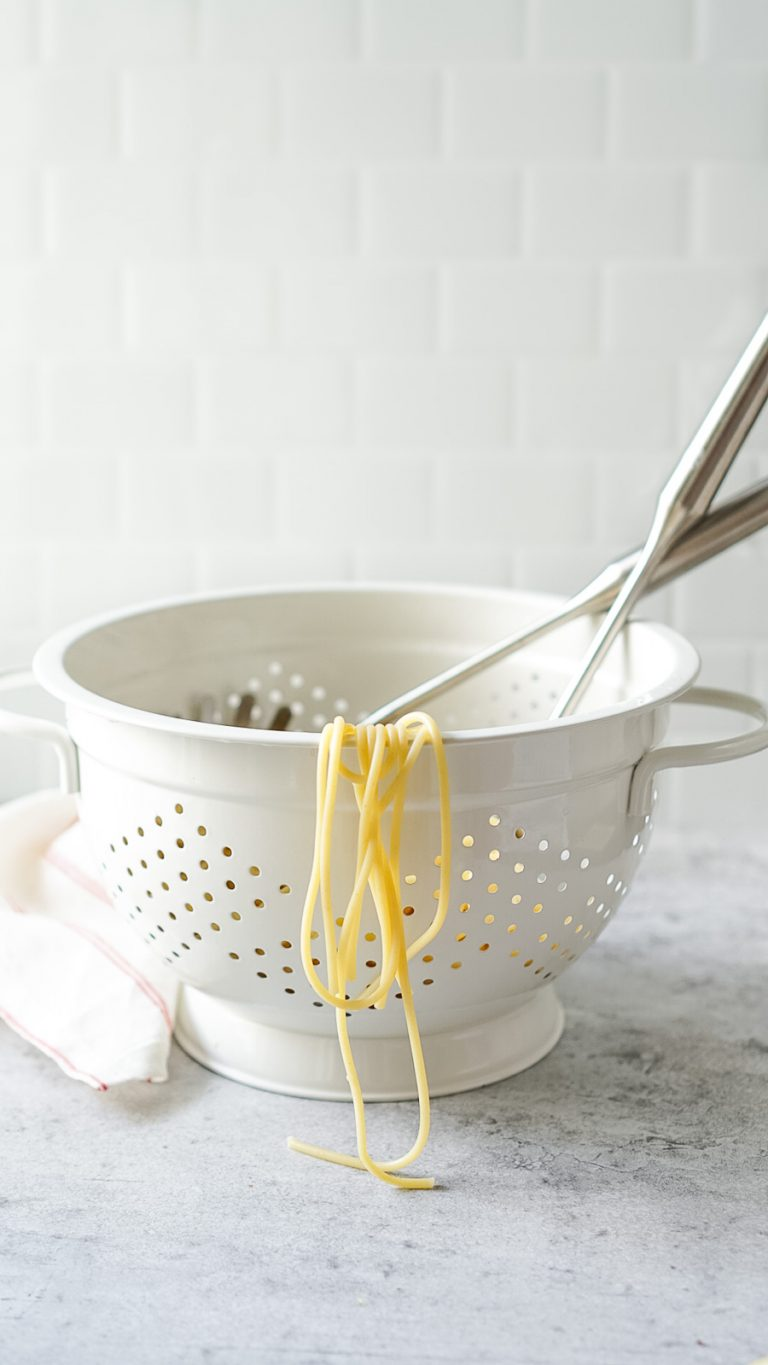 pasta in a white strainer