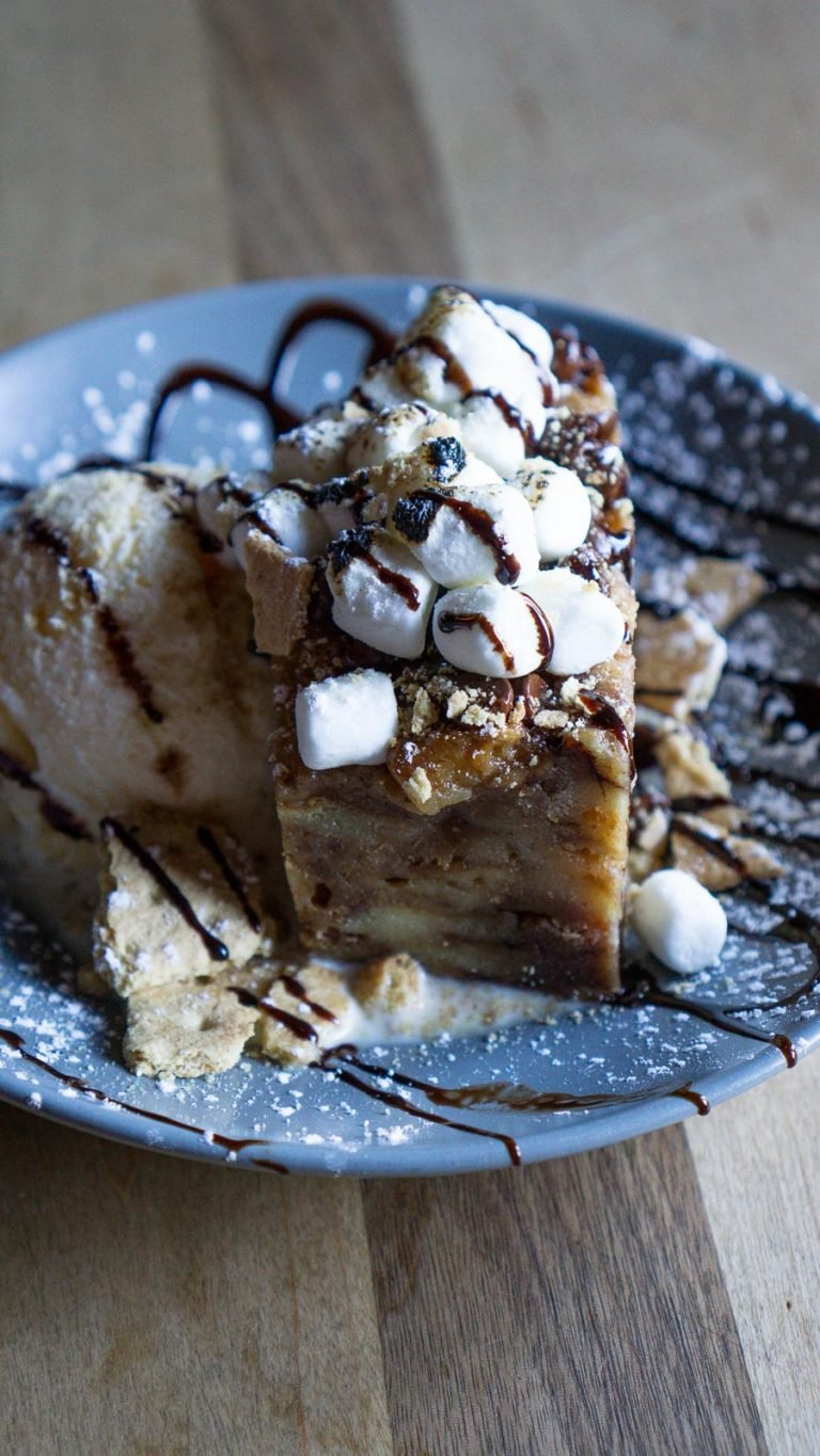 smores bread pudding on a plate with a scoop of ice cream