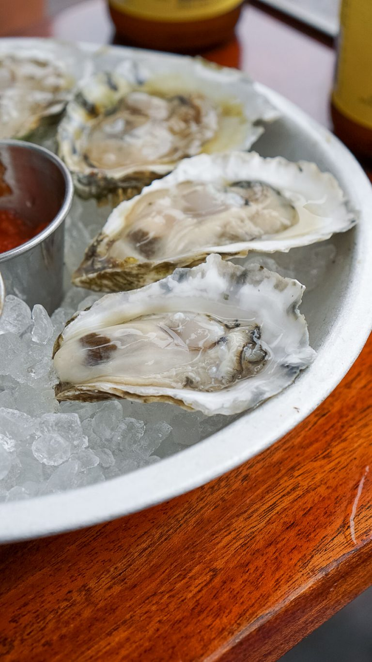 4 shucked oysters on ice from eventide