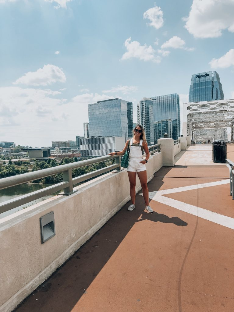 girl standing on the pedestrian bridge in nashville