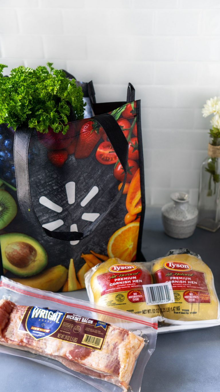 a reusable walmart bag, cornish hens, and a package of bacon