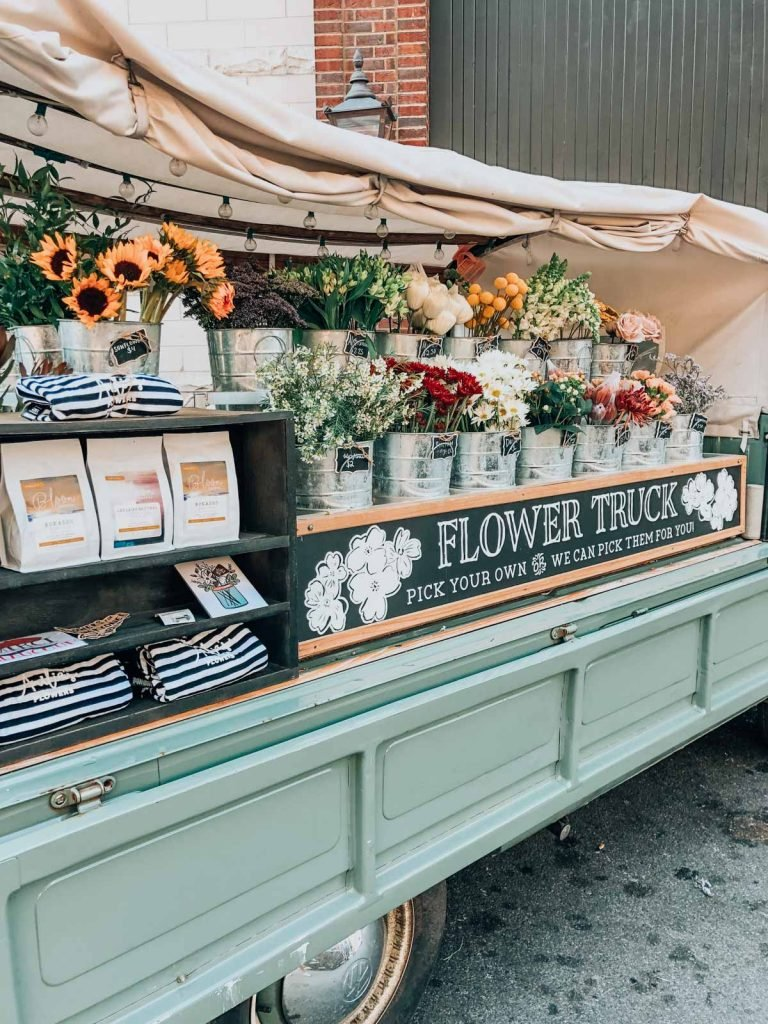 fun things to do in nashville: a flower stand on a light blue truck