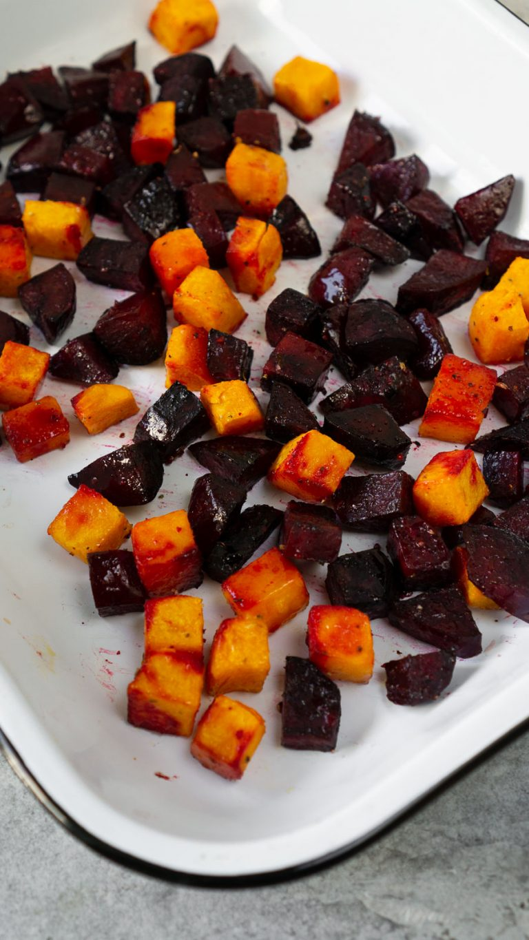 roasted butternut squash and beets in a white baking dish