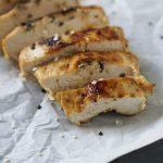 sesame ginger chicken sliced on parchment paper
