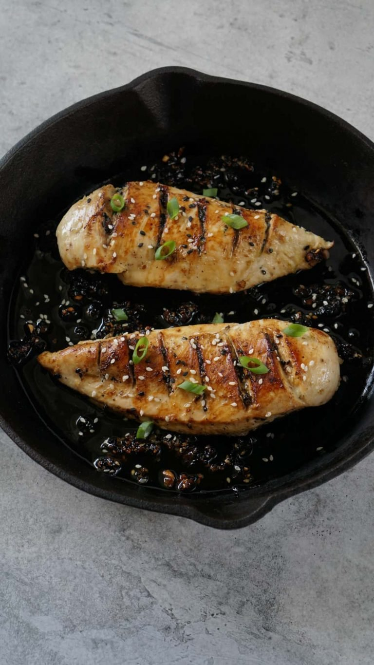 two chicken breasts in a cast iron pan