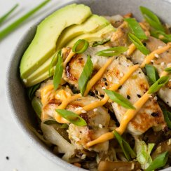 egg roll in a bowl with avocado on top