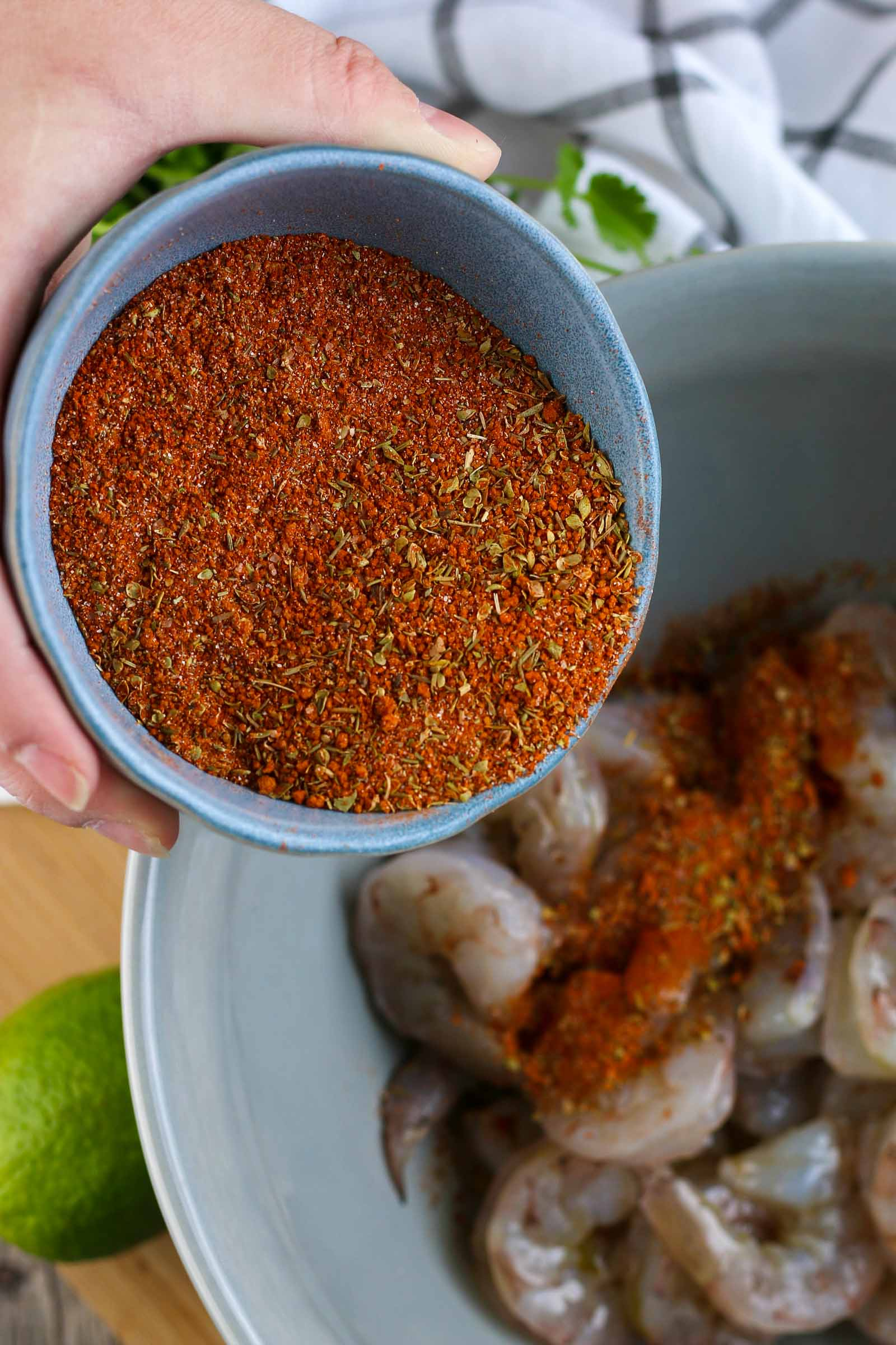 blackened seasoning going onto the shrimp