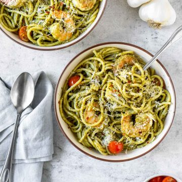 two bowls of basil pesto shrimp pasta