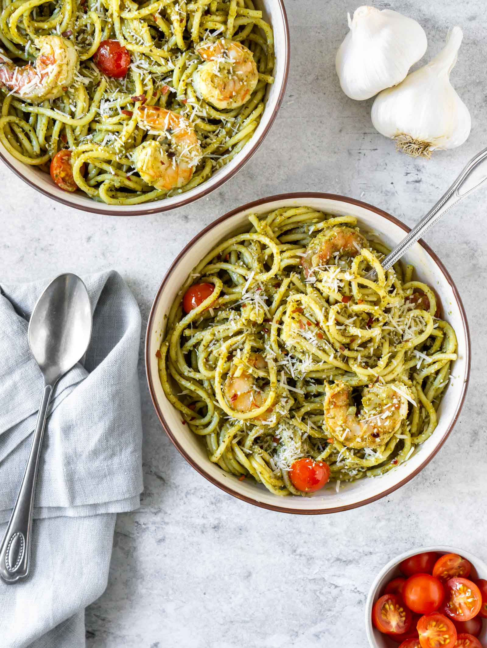 two bowls of basil pesto shrimp pasta