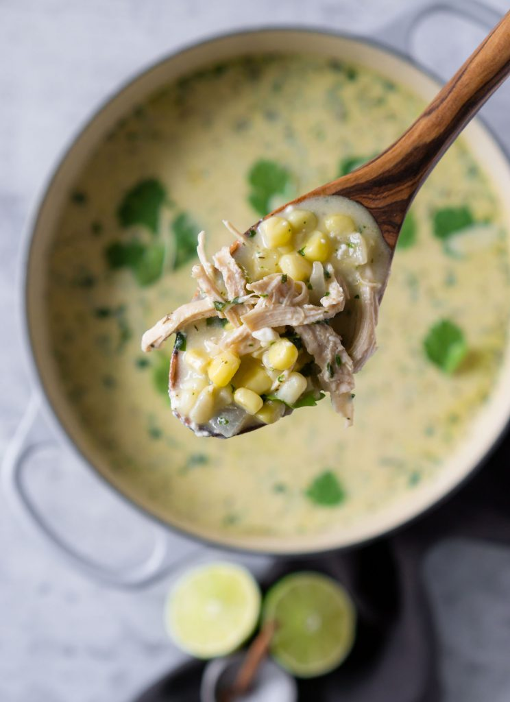 mexican street corn white chicken chili on a wooden spoon