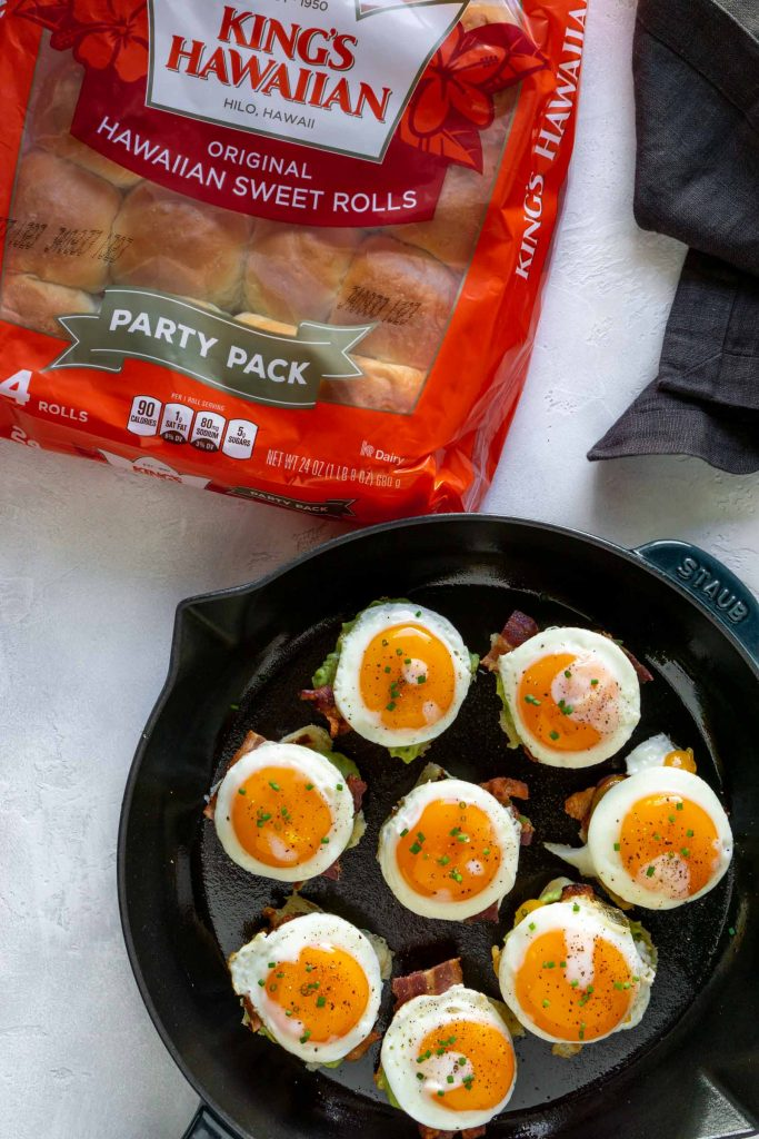 open faced breakfast sliders in a large pan