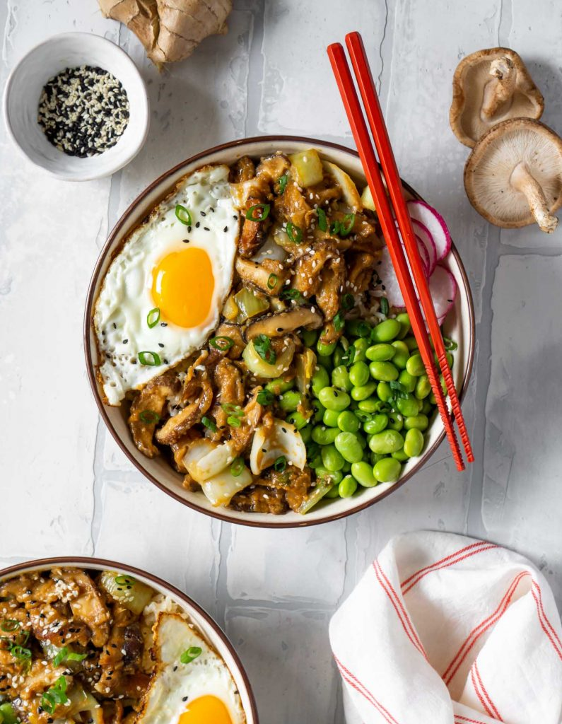 2 maple miso mushroom bowls with red chopsticks
