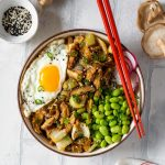 miso mushroom bowl with red chopsticks
