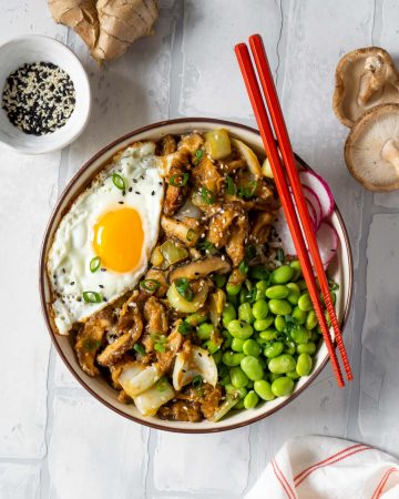 miso mushroom bowl with red chopsticks