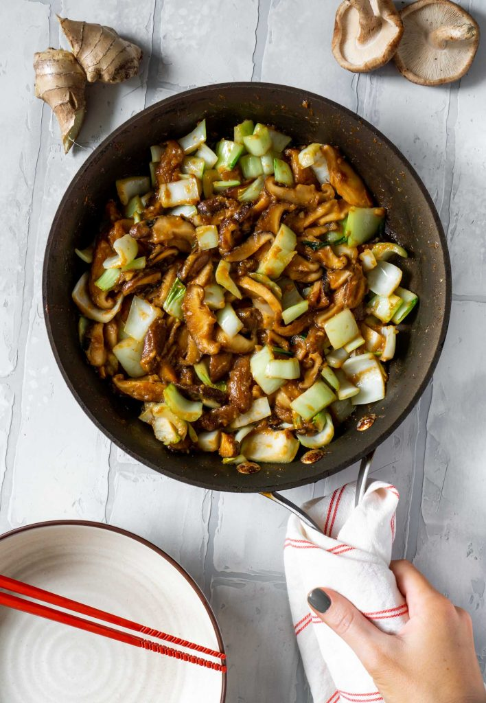 miso butter mushrooms and bok choy in a pan