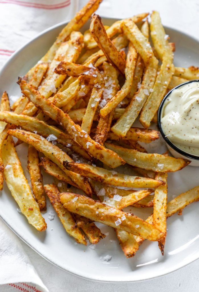 garlic parmesan fries on a plate with mayo