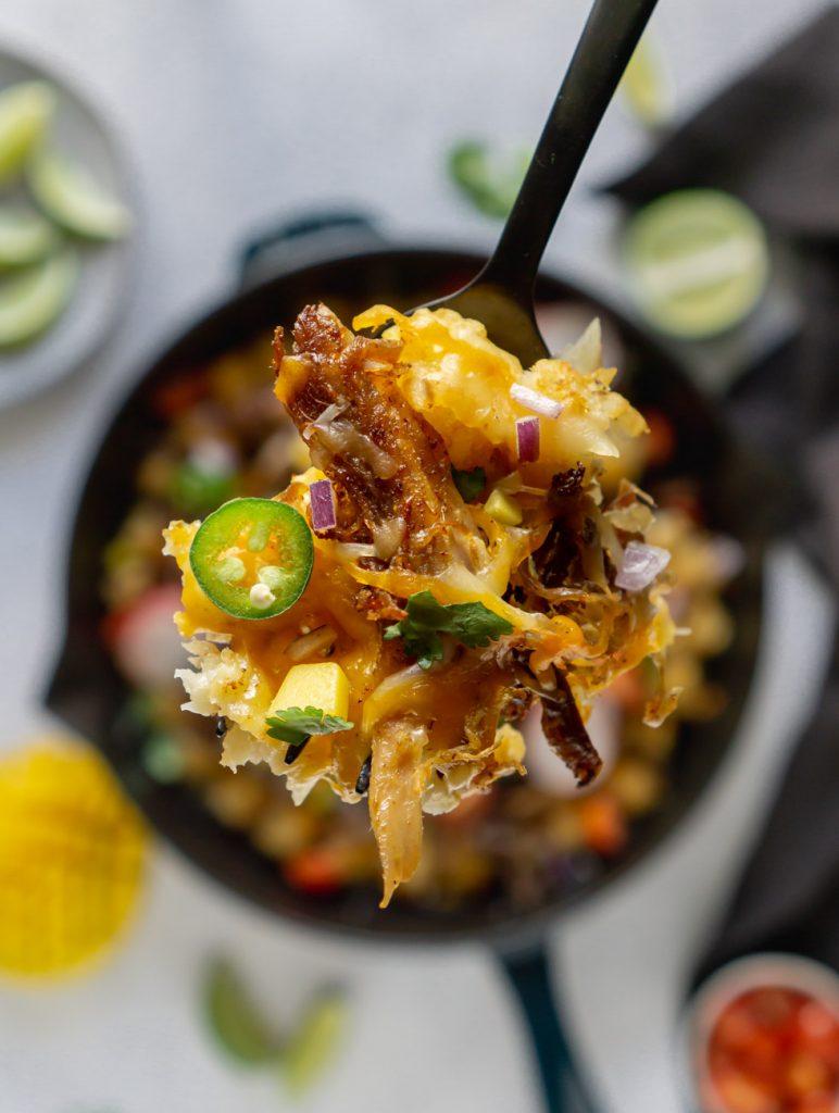 tater tot nachos on a black fork