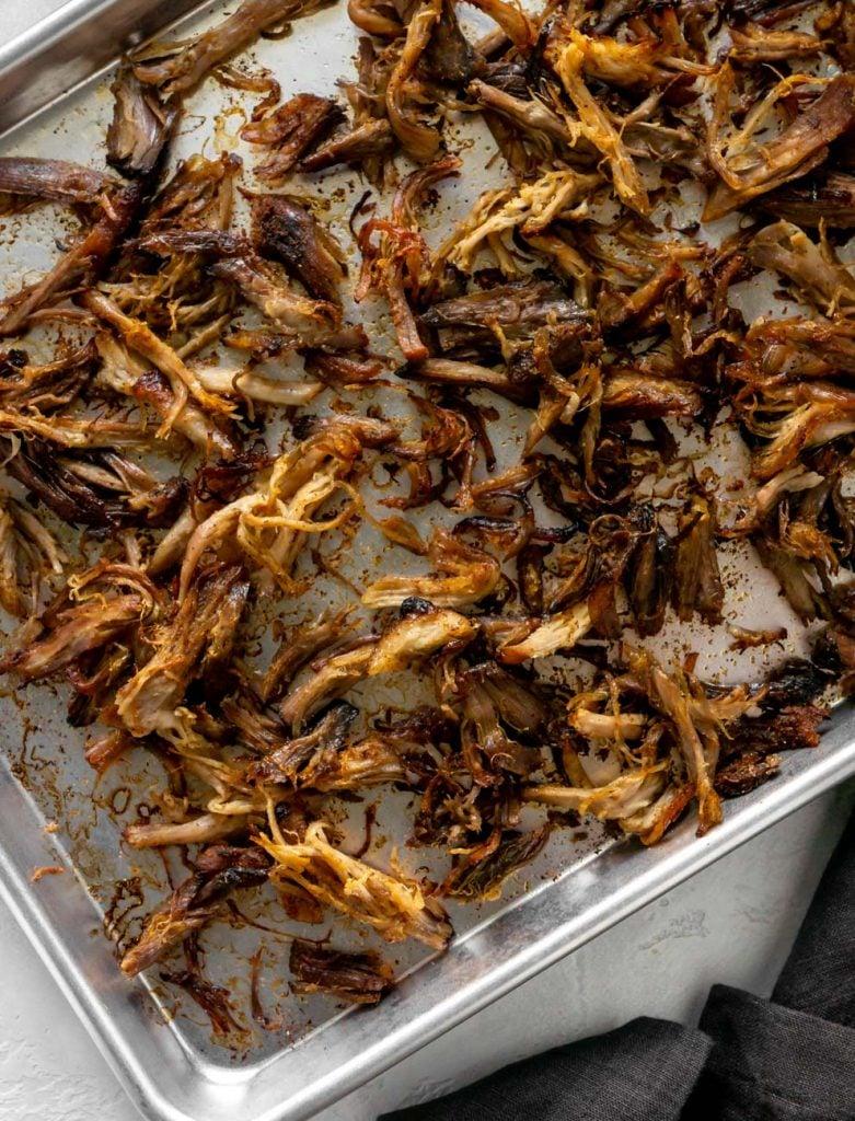 slow cooker carnitas on a sheet pan