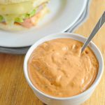 5 ingredient chipotle aioli in a small white bowl with a silver spoon