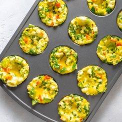 mini egg frittatas in a muffin tin