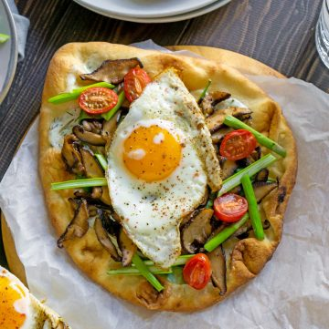 vegetable breakfast pizza on parchment paper