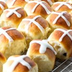 hot cross buns on a cooling rack