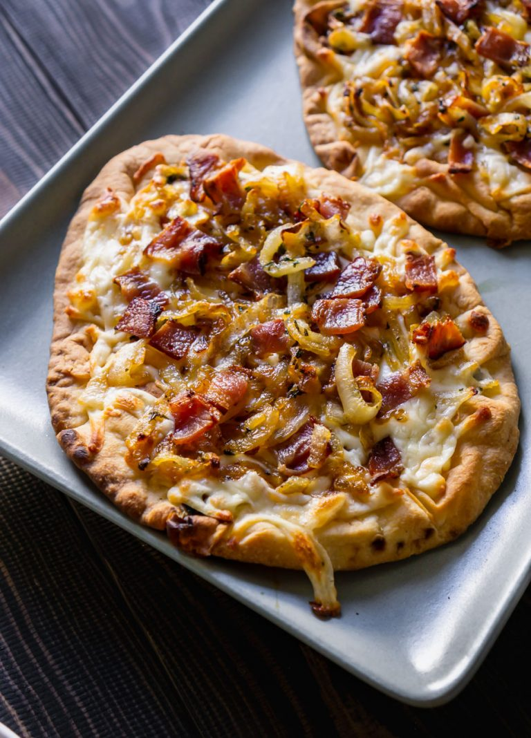bacon pizza on a blue serving tray