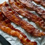candied bacon on parchment paper